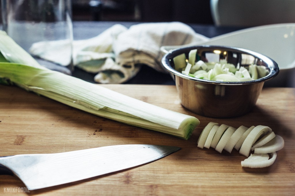 Cut leeks in half and clean dirt out before thinly slicing.