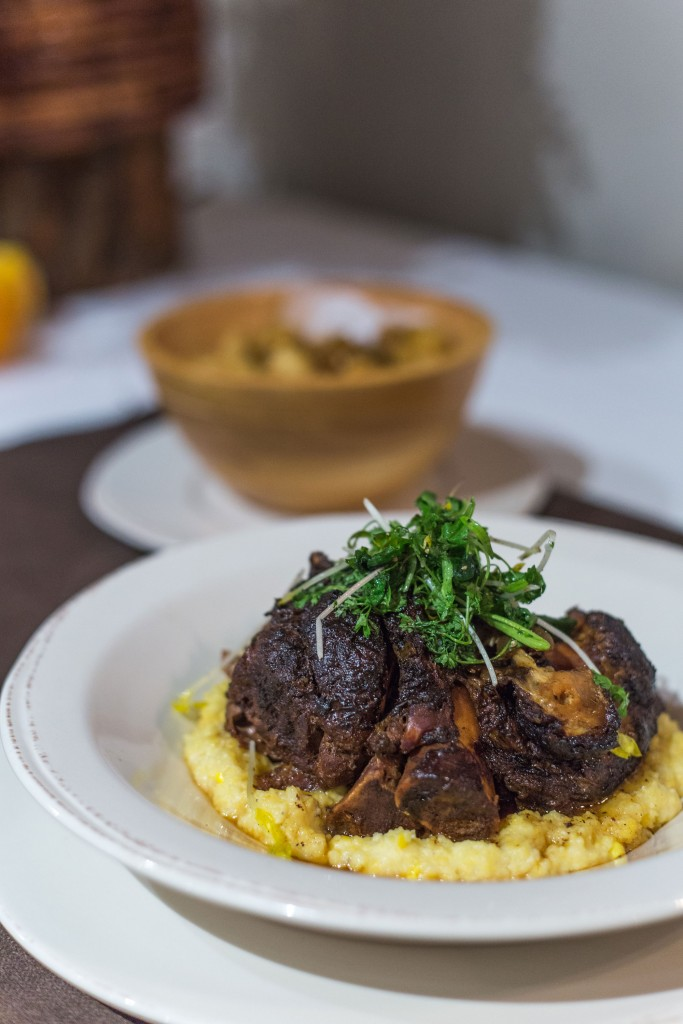 Pork Osso Bucco - Creamed Corn Grits, Garden Cress, and Spiced Brandy Gravy