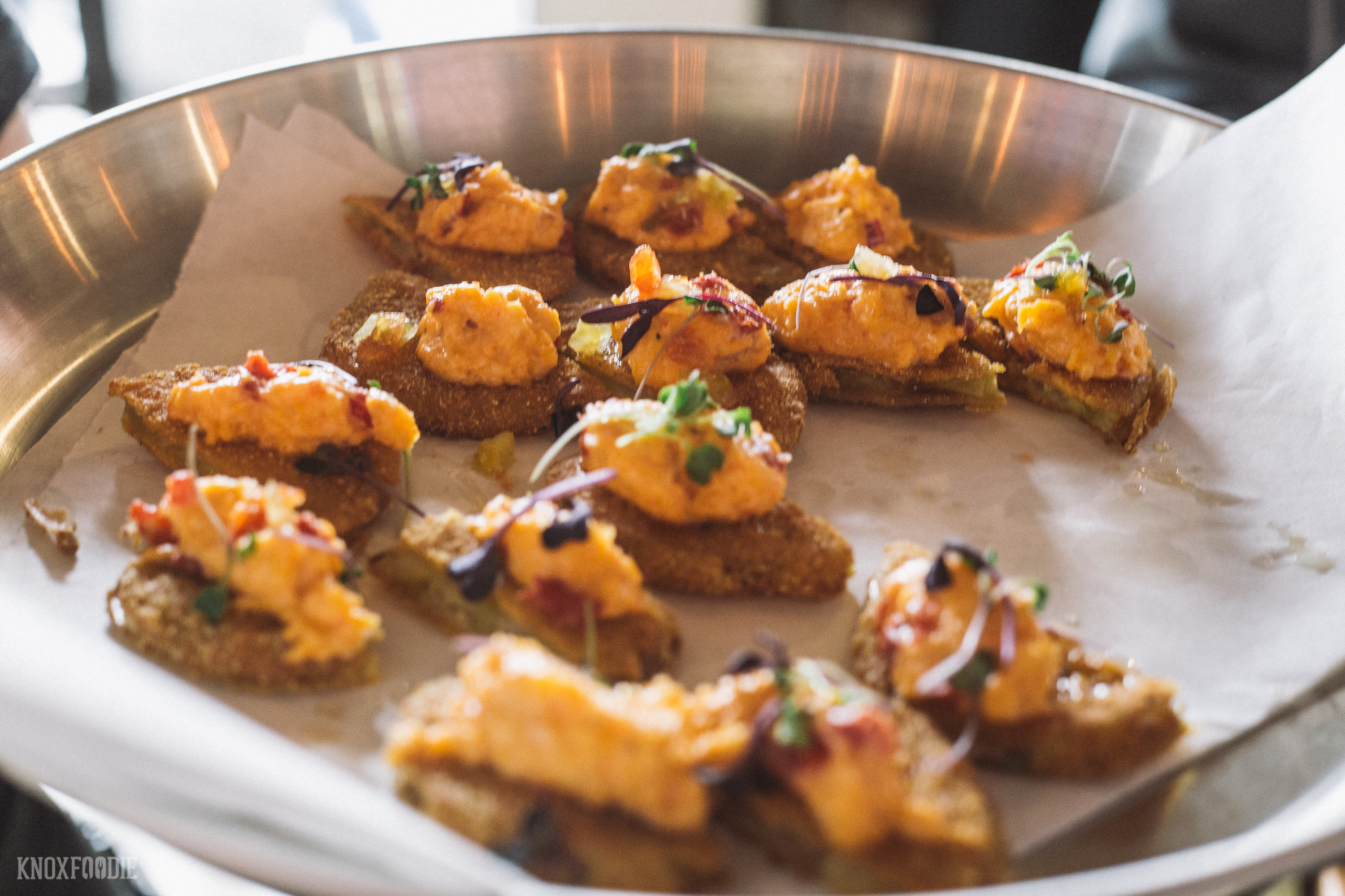 Fried green tomatoes topped with pimento cheese.