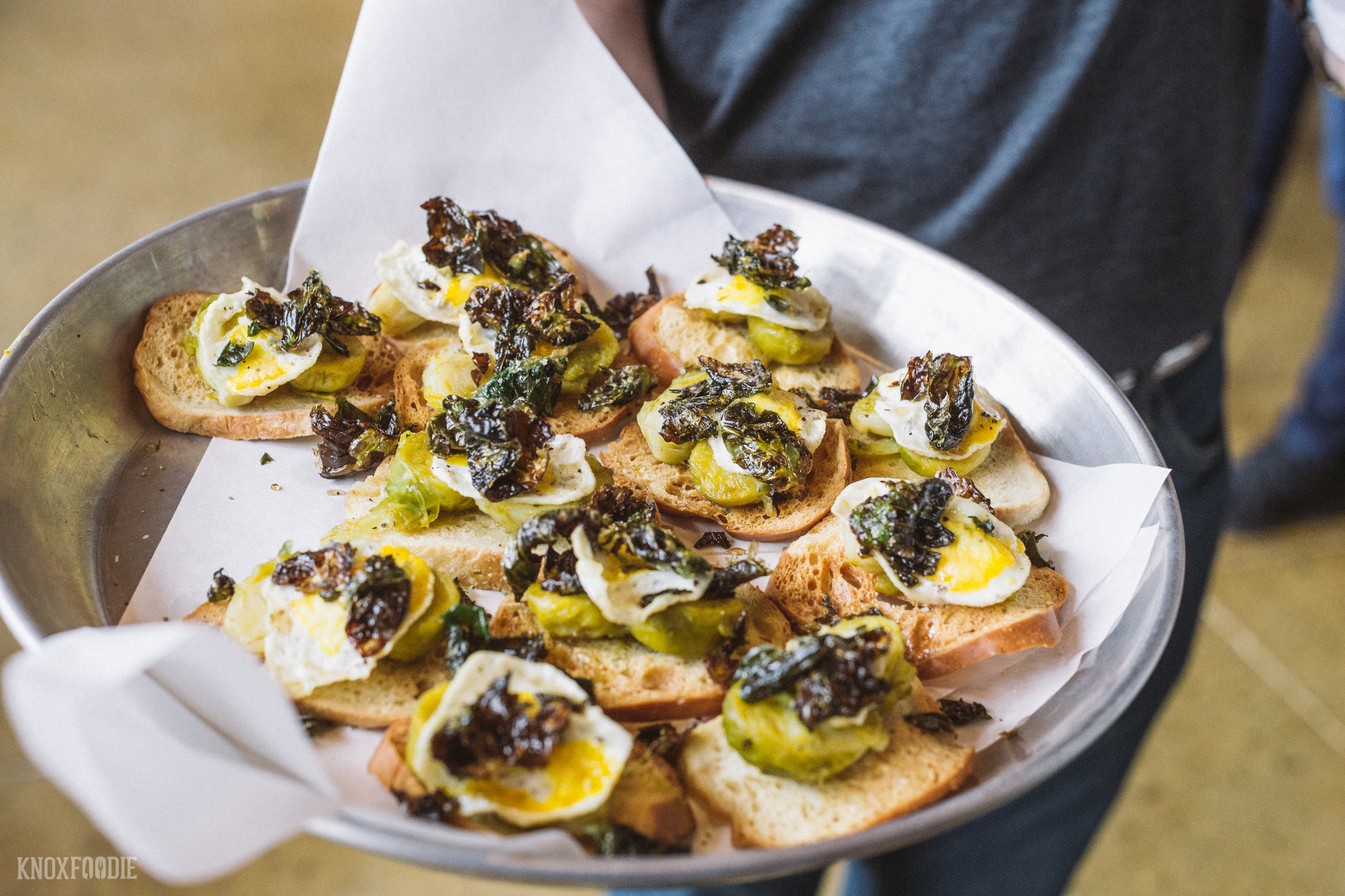 Crostini with roasted brussels sprouts, fried quail egg and maple.