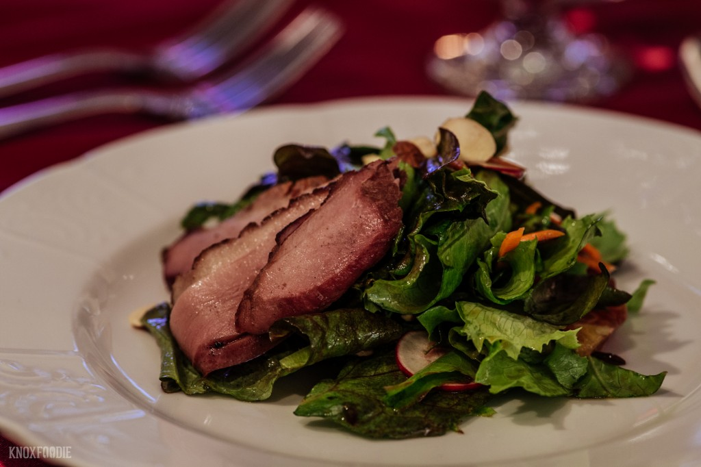 Smoked Duck Breast Salad with local greens, toasted almonds, blood orange, and Ricky Baily Honey Sesame Vinaigrette