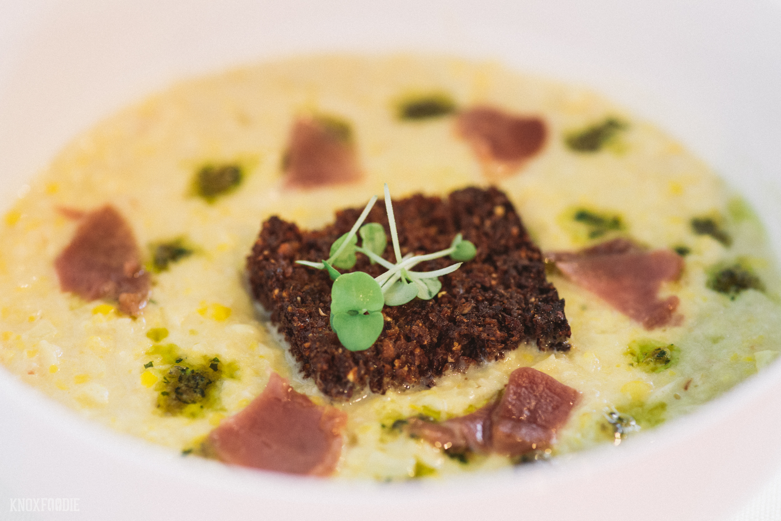 Mr. Knoxfoodie's favorite! Summer Sweet Corn Chowder, roasted corn kernels, shaved country ham, pureed nettle and garlic confit and a Bloody Butcher crouton