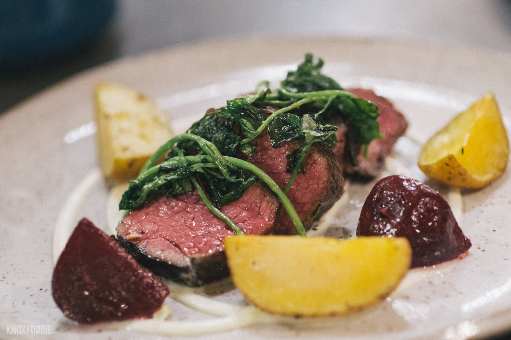Denver Steak, roasted potatoes and beets, wilted watercress at J.C. Holdway